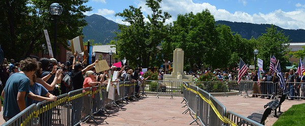 "Members of the alt-right group ""The Proud Boys"" and counter demonstrators face off with each other across barricades set up by  the police at a rally in Boulder, Co."