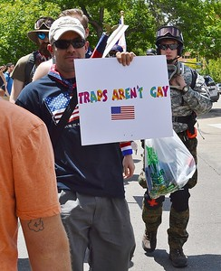 """Traps Aren't Gay"" sign displayed by a member of the alt-right group ""The Proud Boys"" as he departs a rally in Boulder, Co."
