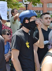 "This young man wears a Star of David to protest the alr-right group ""The Proud Boys"" at a rally in Boulder, Co."