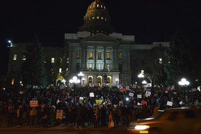 Large crowd of anti Donald trump protesters gather in front of the State Capitol building in Denver.