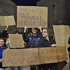Mathematicians hold up signs at Univ. of Colorado-Boulder speech by Milo Yiannopoulos.