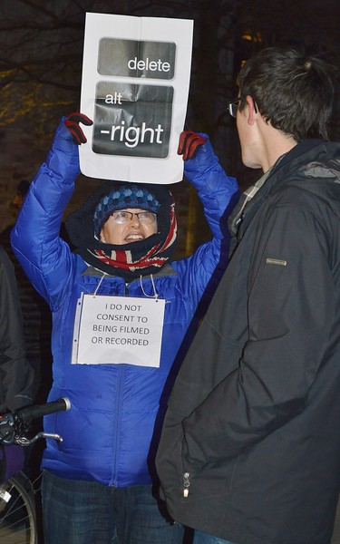 "Woman holds up anti ""alt-right""  sign at protest of speech by Milo Yiannopoulos at Univ of Colorado in Boulder."