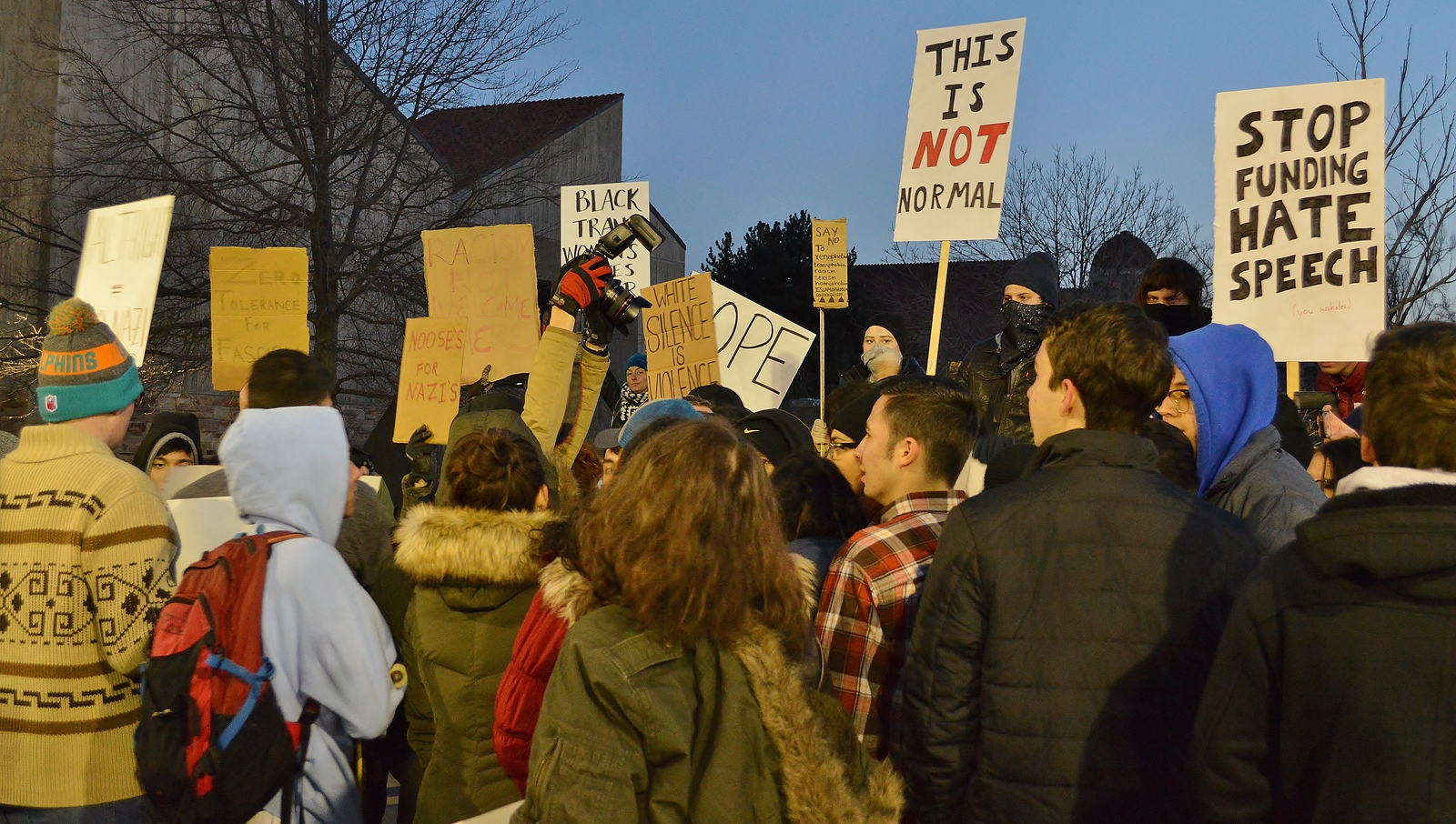 Protesters with signs at speech by Milo Yiannopoulos at Univ of Colorado in Boulder.