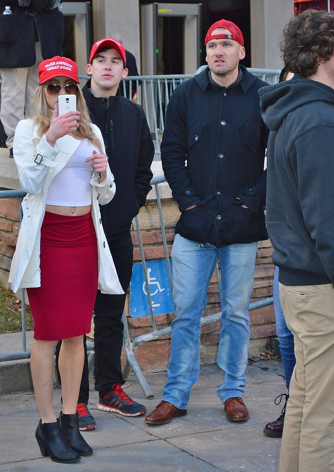 Donald Trump supporter takes cellphone pictures of protesters at Milo Yiannopoulos speech at Univ of Colorado in Boulder.