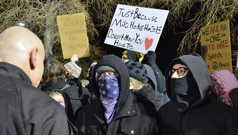 Police and protesters wearing mask face off at speech by Milo Yiannopoulos at Univ of Colorado in Boulder.