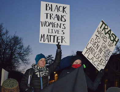 "Woman holds up ""Blacks Lives Matter"" sign at protest against a speech by Milo Yiannopoulos at Univ of Colorado in Boulder."