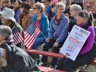 Protesters with signs listen to speaker at anti-Trump rally in Boulder,Co.