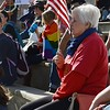 """Woman displaying an American flag at the """"Defend Our Constitution"""" rally in Denver."""