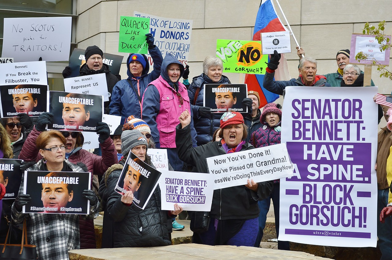 Opponents of President Trumps Supreme Court nominee Neil Gorsuch, rally on a street corner before marching to Democratic Senator Micheal Bennett's office a few blocks away.
