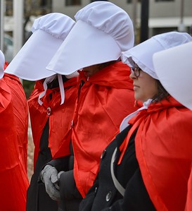 "A large group of women dressed in costumes from the ""Handmaid's Tale"" turned out to protest Vice President Mike Pence who was speaking at a Republican fundraiser in Denver."