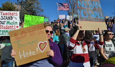 Opponents of President Trumps immigration and refugee ban at protest in Denver.,Co.