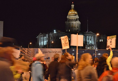 """""""Not My Presidents Day"""" marchers pass by the Colorado State Capitol building in Denver."""