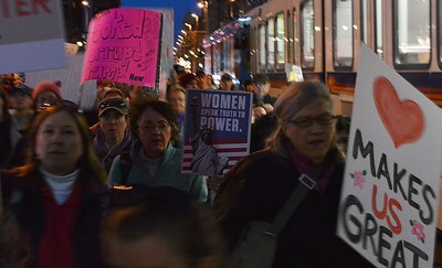 """These women were among hundreds who joined the """"Not My President's Day"""" march through Denver."""