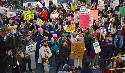 """Opponents of President Trump listen to speakers at the """"Not My President's Day"""" rally in Denver."""