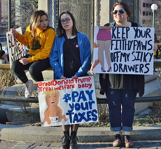 """Anti Trump protesters at """"Not My President's Day"""" rally in Denver."""