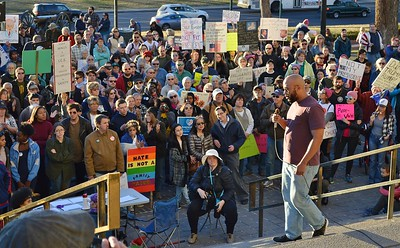 """Large crowd of protesters listen to speaker at """"Not My President's Day"""" rally in Denver."""