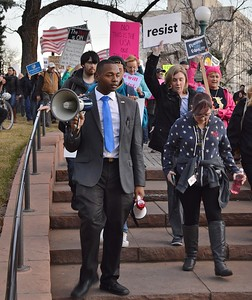 """Young African American man leading a """"Not My President's Day"""" march in Denver."""