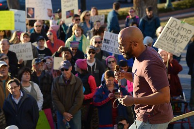 """Speaker addressing the crowd at the """"Not My President's Day"""" rally in Denver."""