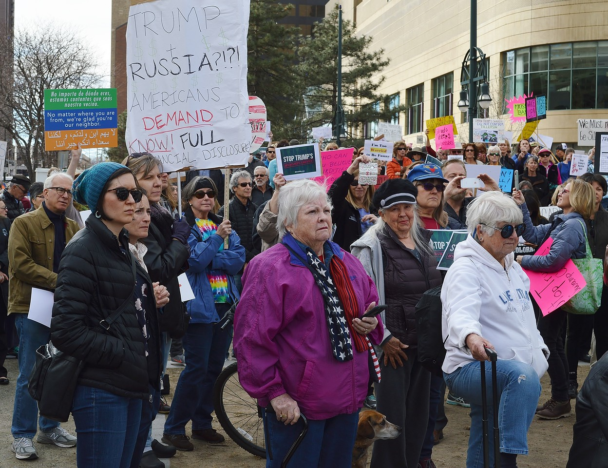 Protesters listen to speaker at Resist Trumps Tuesdays rally in Denver.