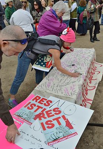 "Large banner being signed by protesters at ""Resist Trump Tuesday"" in Denver, Co."