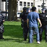 Police face off with counter demonstrators as they try to clear a park after a