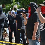 Anarchists, dressed in black, were among the counter demonstrators at the