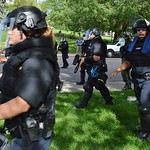 Police clear a park of counter demonstrators after a