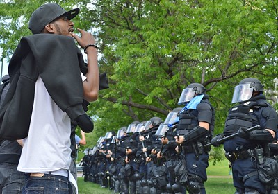"""Police and counter demonstrators face off after a """"Stop Sharia Law"""" rally in Denver."""