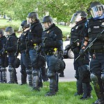 Police in riot gear keep counter demonstrators separate from the