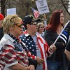 Many supporters of President Trump carried or wore American flags at a rally and march in Denver.