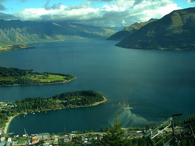 View from the Skyline Restaurant, Queenstown, New Zealand 2005; Christmas Day Steamship TSS Earnslaw in Queenstown Bay with Lake Wakatipu before you.