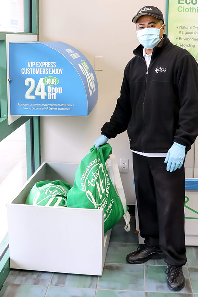 Viseth Keo of Nashua, manager of Anton's Cleaners in Tewksbury, shows the 24-hour drop box that allows for a no-contact drop-off any time of day or night