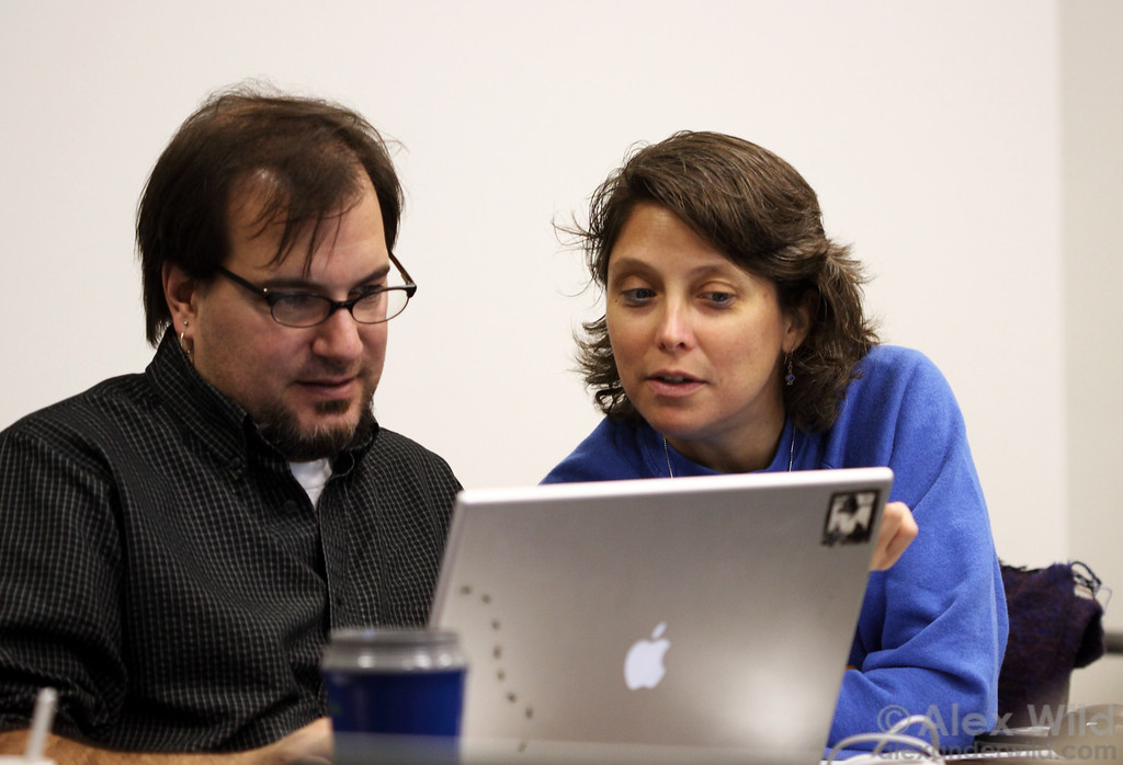 Andy Suarez and Leanne Alonso share notes at a conference. Note the standard myrmecologist's laptop, complete with little ants and a Darwin sticker.
