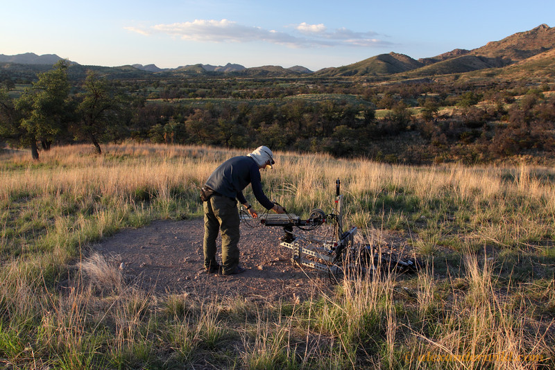 A film crew for a National Geographic documentary sets up a robotic camera on a nest of red harvester ants, Pogonomyrmex barbatus.  Sycamore Canyon, Arizona, USA