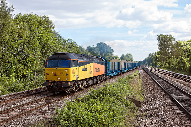 31st Aug 12:  Colas Rail  47739 'Robin of Templecombe' is trusted to power 6Z47 from Dollands Moor to Gloucester.  The load of 28 Log wagons, which had come throug hthe tunnel from Holland, is pictured passig through Tilehurst