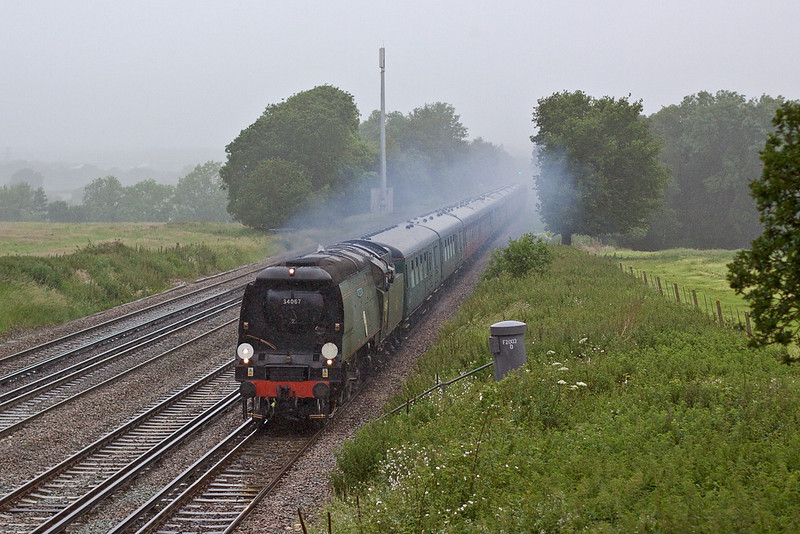 21st Jun 12:  On a horrible evening in very wet rain  Tangmere on the rise between Hook and Winchfield.  1Z87 is running from Swanage to Victoria.  1/800 @ f2.5, iso 800.  Canon 50mm f1.4 prime
