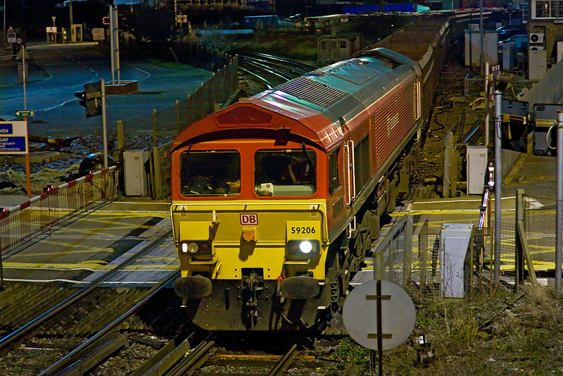 12th Jan 12:  It is 12.30 as 59206 easing back from Newhaven Maritime sidings with a rake of JNAs tailed by 66124.  They will stop on the Up Main, north of the Town Station, to be loaded with ash from the newly opened recycling plant and then be taken to Day's depot at Brentford.  The line to Seaford can be seen curving away behind the loco. This was the first day of the service