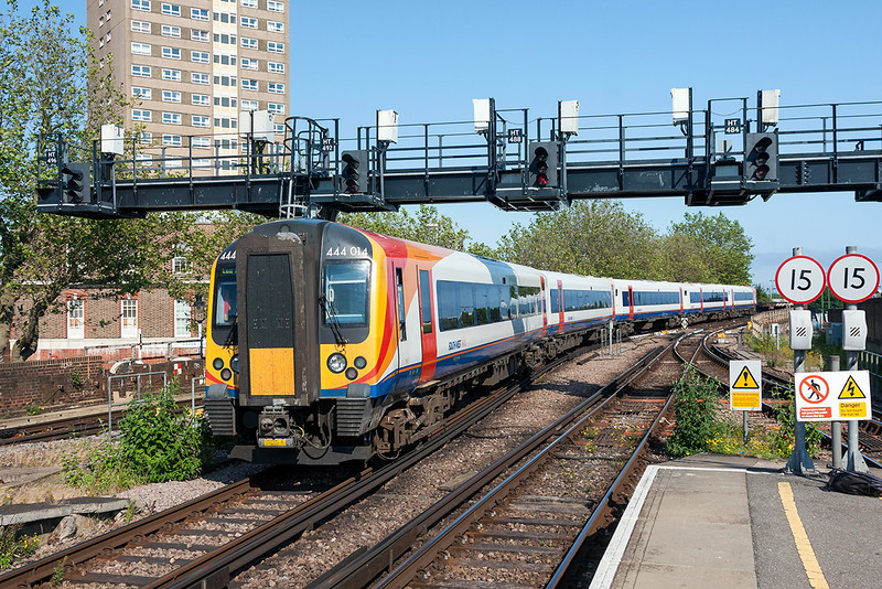 4th Jul 13:  The 17.19 from Portsmouth Harbour to Waterloo in the hands of 444014 departs from the harbour station