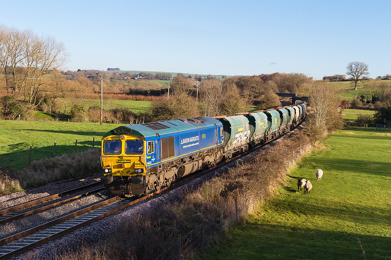 11th Jan 14:  With the shadows lengthening 66623 'Bill Bolsover' makes a splendin sight at it cruises through Great Cheverell with the Theale Wool sand empties.