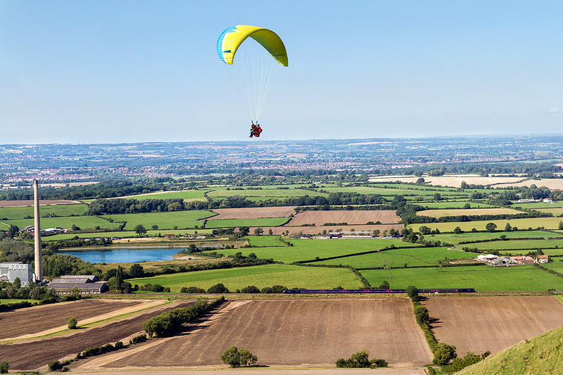 6th Sept 2015:  The old cement works chimney a tandem hang glider and 1A85 the 11.01 from Penzance to Paddington, taken from Westbury White Horse