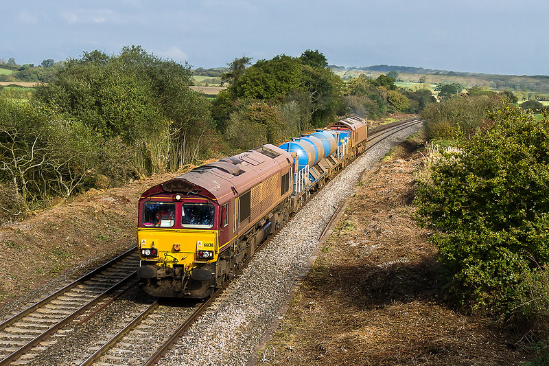 13th Oct 2015: Considderable tree clearance has ecently taken place at Strap Lane, near Upton Noble in Somerset, opening up this shot.  660138 TnT 66061 is working 3J13 from Westbury to St Blazey, not spraying though.