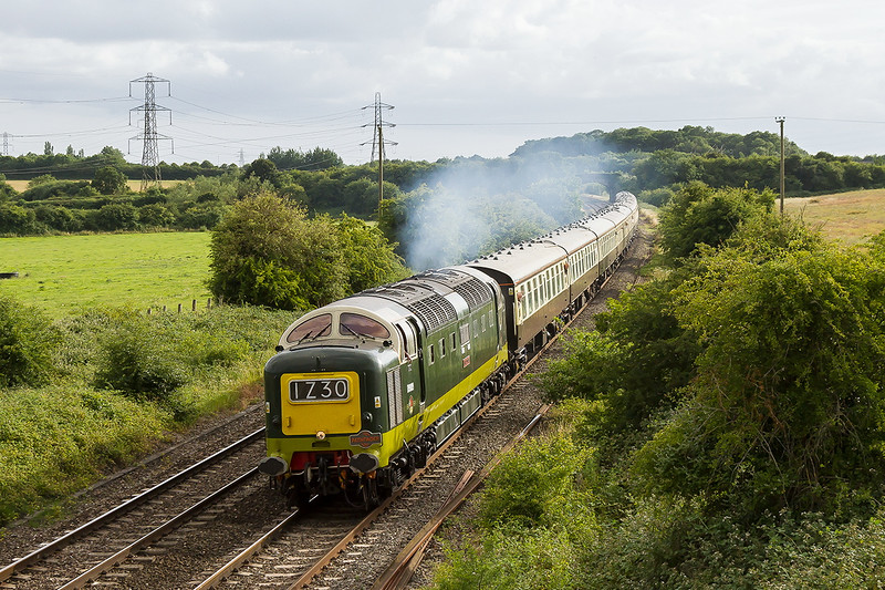 4th Jul 2015:  Miraculously catching some sunlight at Berkley D9009 'Alycidon' makes a fine sight and sound as it accelerates away from Clink Road Junction.  Originally 1Z30 was booked to return Derby using the direct line between Taunton and Bristol Temple Meads but early in the day it was rerouted to Run via Westbury.  Thank you very much say I.