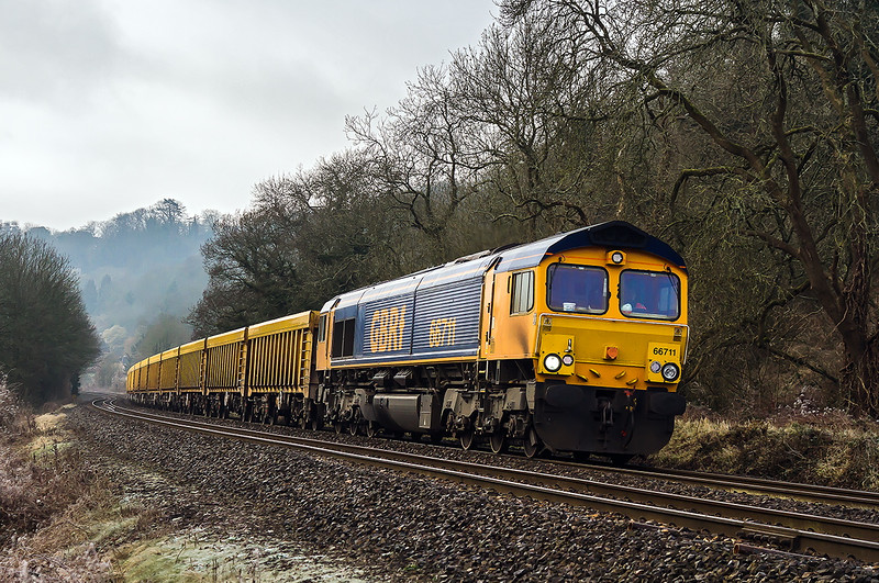 9th Feb 2015:  With the line closed between Banbury and Leamington, due to a severe land slide at Harbury, the Westbury to Stud Farm has been re-routed and re-coded to run 2  3/4 hours earlier.  66711 is pictured at Limpley Stoke in the Avon Valley  on the first diverted run of 6M25.<br /> 60 years earlier there was a 3rd track behind the loco which originally went to Camerton and was last used in the making of the 'Titfield Thunderbolt'.