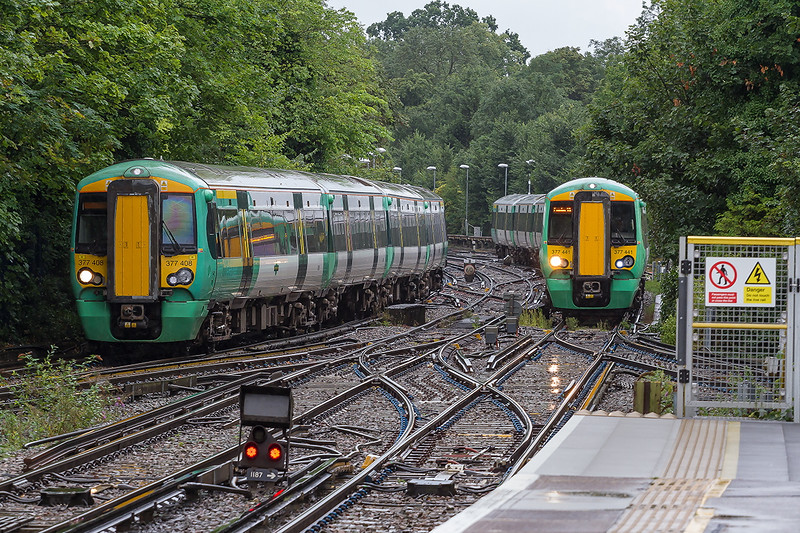 26th August 2015:  On a particulrly foul day 377408 moves from the Down Siding into Platform 1 at Epson to form 3E39 the 11.49 to Victoria as 377441 runs into Platform 2 with 2E37 the 11.04 from Horsham to Victoria.  It is nice to see a three way turn out laid on concrete sleapers.