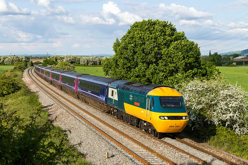 23rd May 2016:   At last a picture in the sun of the original first HST Power Car, Unveiled at the  St Philips Marsh-HSTD in Bristol 43002 (253001) is now the new star of HST services working out of Paddington. It has been repainted as accurately as possible into the livery it was delivered in  40 years ago in 1976.  Name plates are now applied to honour  'Sir Kenneth Grange' the man who designed the train  back in the 1970's. Pictured here at Bekley Marsh working 1C89 the 17.03 from Paddington to Penzance