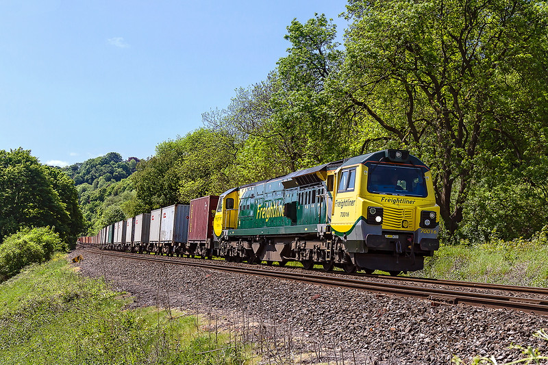 24th May 2016:  Due to a failure of the booked power 70016 was stepped up and the train re routed via the Wylye and Avon Valleys as 4Z50.  Pictured here at Fishers Crossing in Limply Stoke the train is braking for the slack under the Dundas Viaduct.