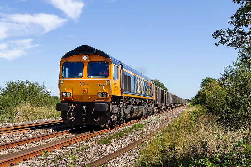 23rd Aug 2016:  One of the Ex Continental 66s 66750 on the point of 6V41 from Wellingborough to Whatley Quarry at Masters Crossing to the west of Fairwood Junction
