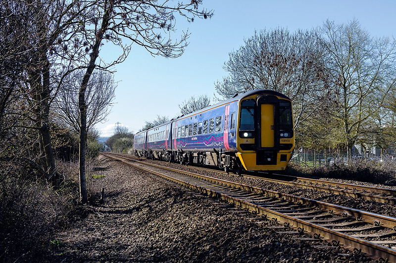 17th Apr 2016:  Passing the White Horse Business Park in North Bradley is 158950 which is working 1F10 the 09.35 from Frome to Swindon. I did not expect a 3 car unit as the Westbury/Frome Swindon shuttles at usually a single 153 unit