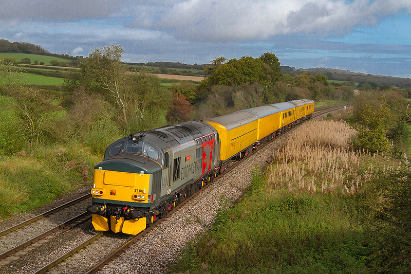 12th Oct 2017:  The light fortunately improved as the horn was heard as 3Q60 passed through East Somerset Junction a mile or so to the East.  Europhoenix 37611 looks great powering the tester as it runs from Westbury to Weymouth
