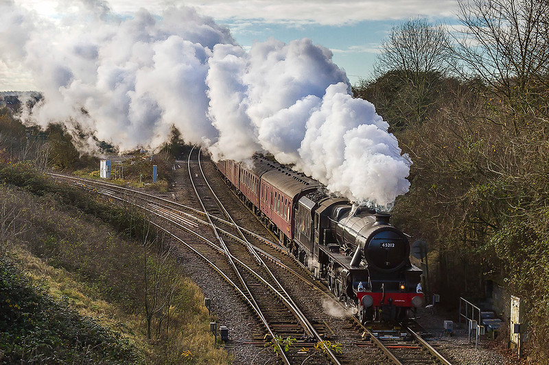 30th Nov 2017:  The Railway Touring Club tour to 'The Bath Christmas Market' was due to be hauled by  'The Union of South Africa' but regrtably, this was now not available.  The stand in was LMS 4-6-0 45212 which I had never seen before.  The train is captured from the 'Shallow Wagon Lane'  bridge at Hawkeridge Junction.  The line turning to the left is the 1942 built curve that connects to the Berks & Hants line.